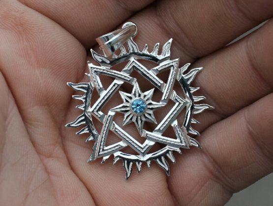 Оберег из серебра звезда Сварога с голубым топазом